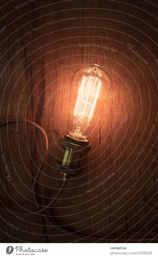 Vintage light bulb on old wood Night life Entertainment Party Going out Technology Energy industry Renewable energy Know Inspiration Electric bulb Lamp Retro
