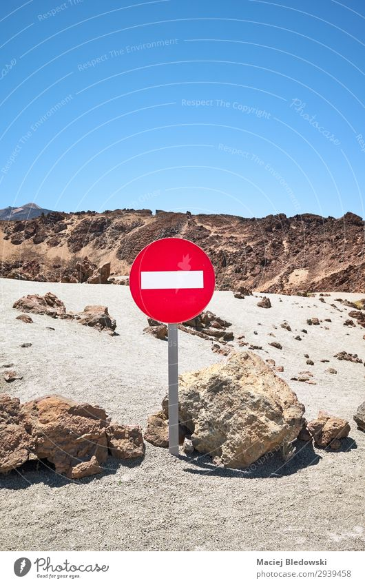 Mars like landscape with No Entry traffic sign. Vacation & Travel Tourism Mountain Nature Landscape Sand Sky Rock Volcano Loneliness Problem solving Fiasco Risk