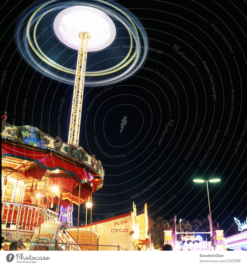 Flea circus. Town Populated Carousel Tower Fairs & Carnivals Oktoberfest Tourist Attraction Threat Famousness Glittering Large Infinity Cold Crazy Speed Many