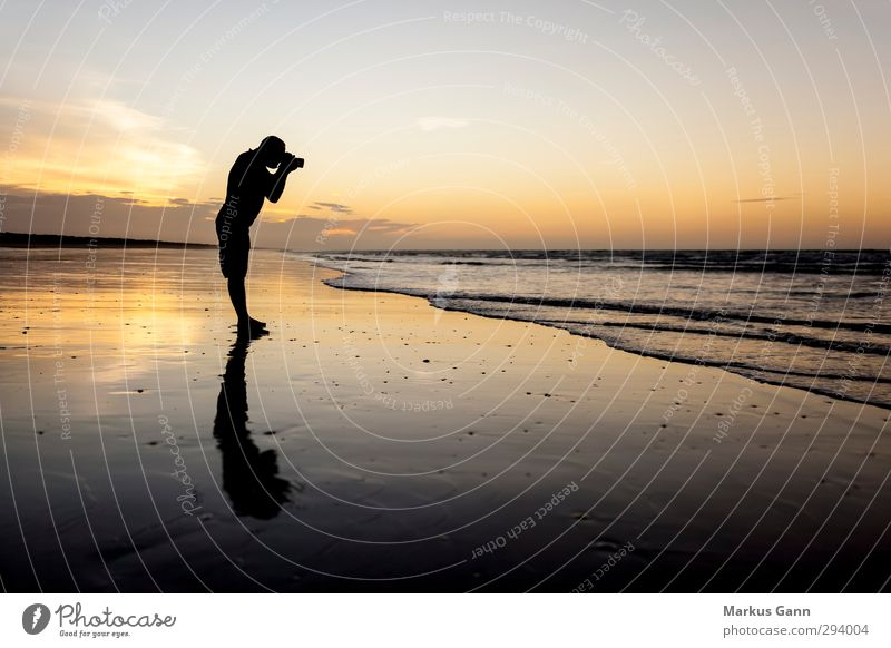 Human being Sky Nature Man Vacation & Travel Water Summer Clouds Landscape Beach Adults Yellow Warmth Emotions Freedom Gray