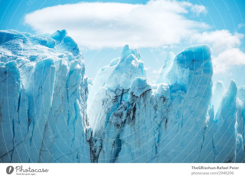 iceberg Nature Landscape Blue Turquoise White Snow Ice Glacier Perito Moreno Glacier Dirty Crack & Rip & Tear Point Clouds To break (something) Colour photo