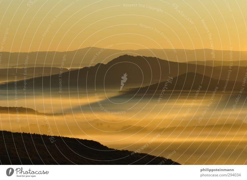 Sunrise In Der Vorderrhön Leisure and hobbies Mountain Nature Landscape Horizon Sunset Sunlight Beautiful weather Fog Highlands Rhön Warmth Yellow Gold Orange