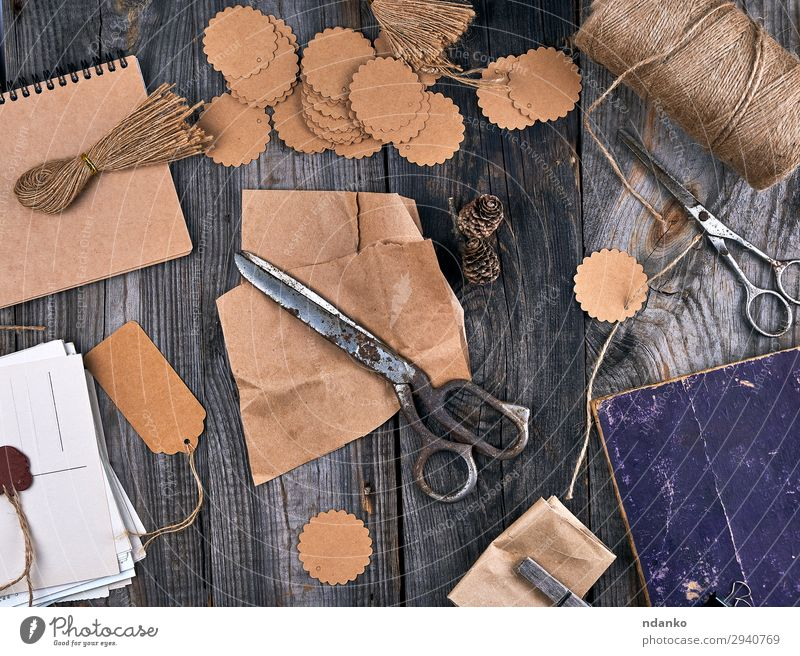 coil of brown rope, paper tags and old scissors Design Leisure and hobbies Decoration Table Craft (trade) Scissors Rope Paper Package Wood Line Old Small Above