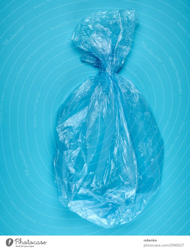 blue plastic bag for garbage on a blue background Blue Colour Environment Vantage point Clean New Plastic Trash Top Conceptual design Environmental pollution