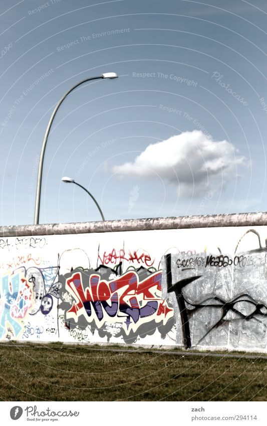 Sky Blue City Clouds Graffiti Wall (building) Grass Berlin Architecture Wall (barrier) Gray Concrete Characters Transience Digits and numbers Historic