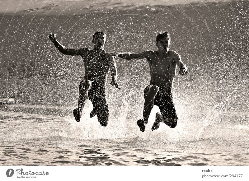 Running in Human being Child Youth (Young adults) Summer Beach Young man Life Playing Happy Swimming & Bathing Jump Healthy Friendship Together Masculine Wild
