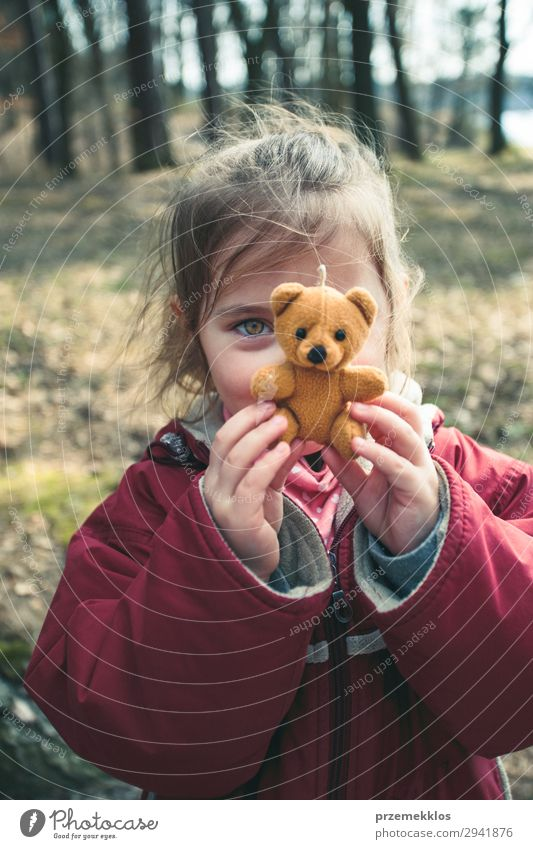 Little girl playing with her little teddy bear toy in a park Lifestyle Joy Beautiful Playing Summer Child Woman Adults Infancy Park Playground Jacket Toys