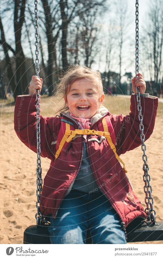Little smilling girl swinging in a park on sunny spring day Lifestyle Joy Happy Beautiful Playing Summer Child Woman Adults Infancy Park Playground Jacket