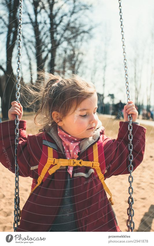 Little cute girl swinging in a park on sunny spring day Lifestyle Joy Beautiful Playing Summer Child Woman Adults Infancy Park Playground Jacket To enjoy