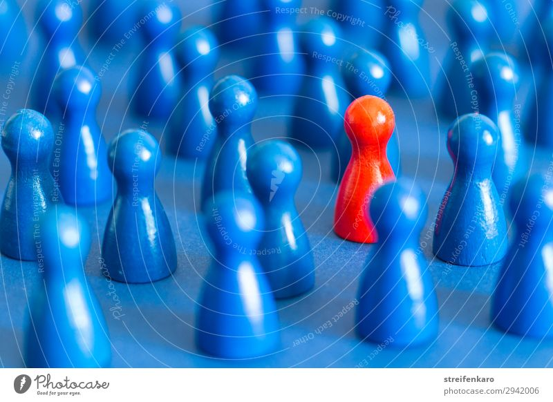 Single red figure between many blue figures on blue background Playing Board game Group Toys Wood Sign Select Together Uniqueness Rebellious Blue Red