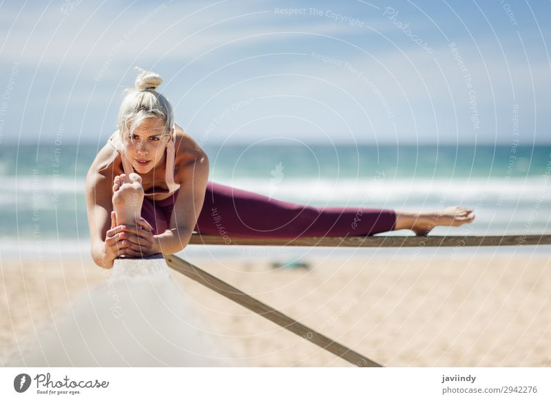 Caucasian blonde woman practicing yoga in the beach Lifestyle Beautiful Body Harmonious Relaxation Meditation Summer Beach Ocean Sports Yoga Human being