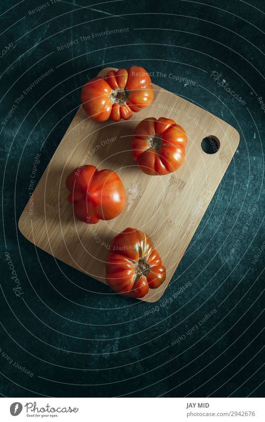 Fresh red Marmande RAF red tomatoes on wooden table Vegetable Fruit Nutrition Vegetarian diet Diet Garden Table Nature Natural Clean Green Red Colour Tomato