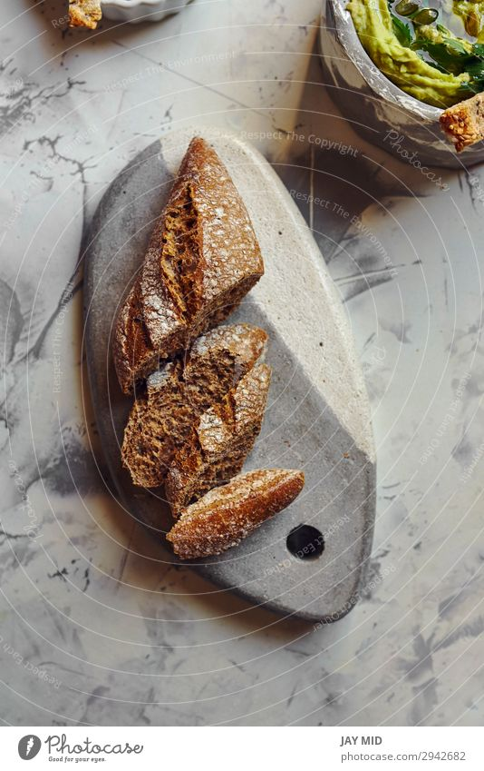 Rye bread, cut into slices Food Dairy Products Bread Nutrition Eating Breakfast Organic produce Vegetarian diet Diet Dark Fresh Delicious Natural Brown Black