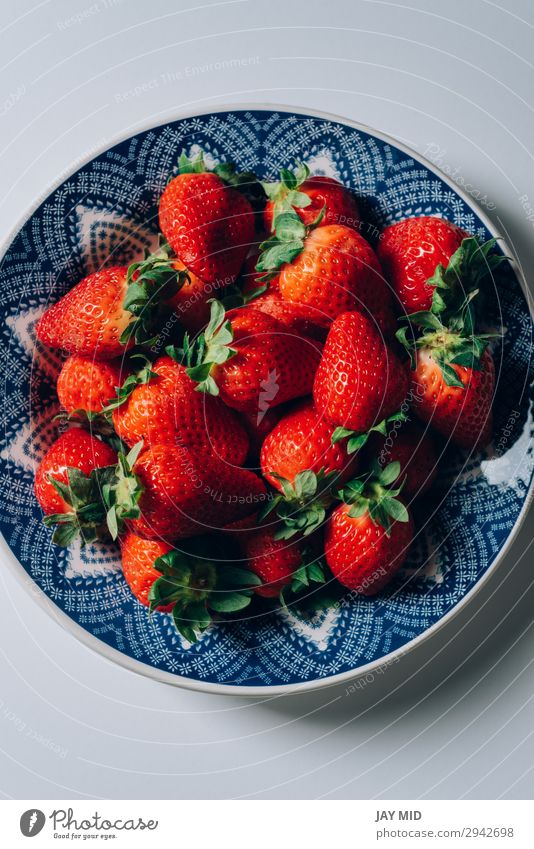 Fresh ripe strawberries in a blue and white plate Fruit Dessert Nutrition Breakfast Lunch Dinner Organic produce Vegetarian diet Plate Bowl Summer Table