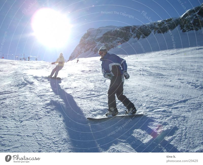 Sun Snow Sports Leisure and hobbies Beautiful weather Alps Curve Downward Glacier Ski resort Swing Snowboard Winter vacation Ski run Snowboarding Spirited