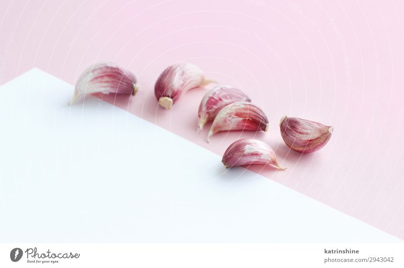 Fresh garlic on a light pink background White Copy Space Herbs and spices Vegetable Decline Vegetarian diet Conceptual design Raw Organic Minimal Monochrome