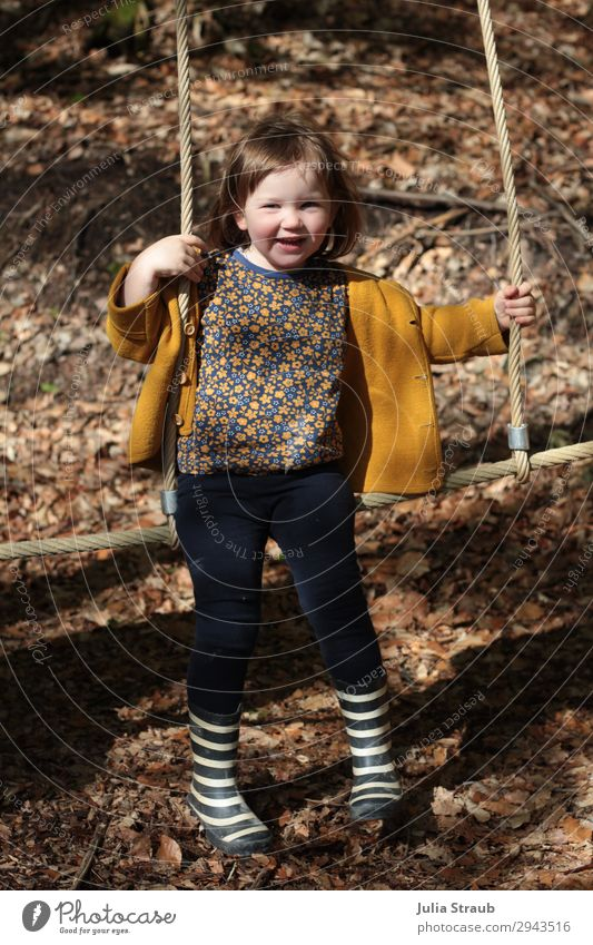 girls climbing frame forest playground Feminine Toddler Girl 1 Human being 1 - 3 years Wool jacket Rubber boots Stripe Brunette Short-haired Bangs Hang Laughter