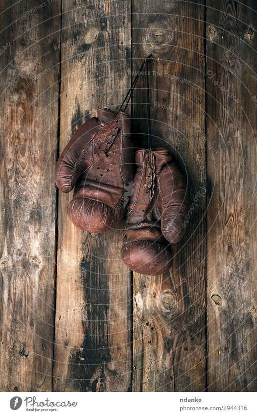 very old leather brown boxing gloves hang Lifestyle Sports Rope Leather Gloves Wood Old Fitness Hang Dirty Retro Brown Protection Competition Action Ancient