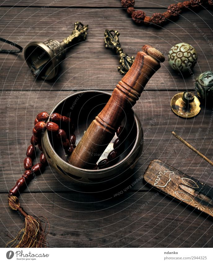 copper singing bowl and a wooden stick Bowl Lifestyle Health care Medical treatment Alternative medicine Wellness Relaxation Meditation Massage Table Music Yoga