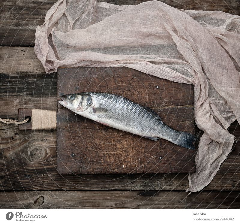 fresh whole sea bass fish Seafood Nutrition Ocean Kitchen Animal Wood Fresh Above Brown Gray board cooking labrax one Raw scale Chopping board Napkin