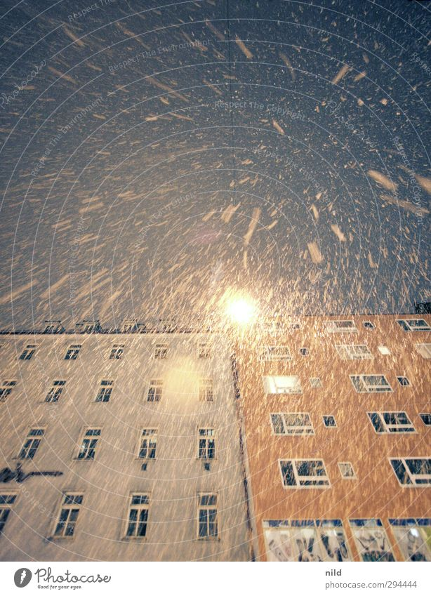 blow snow Winter Weather Bad weather Wind Snow Snowfall Munich Town House (Residential Structure) Facade Street lighting Blue Yellow Orange Cold Upward