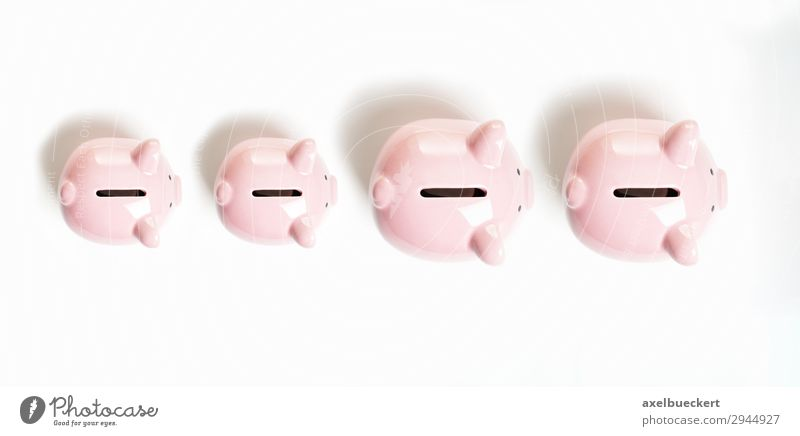 Piggy bank family Financial Industry Financial institution Business Family & Relations Pink Money box Save Accretion Luxury Colour photo Interior shot