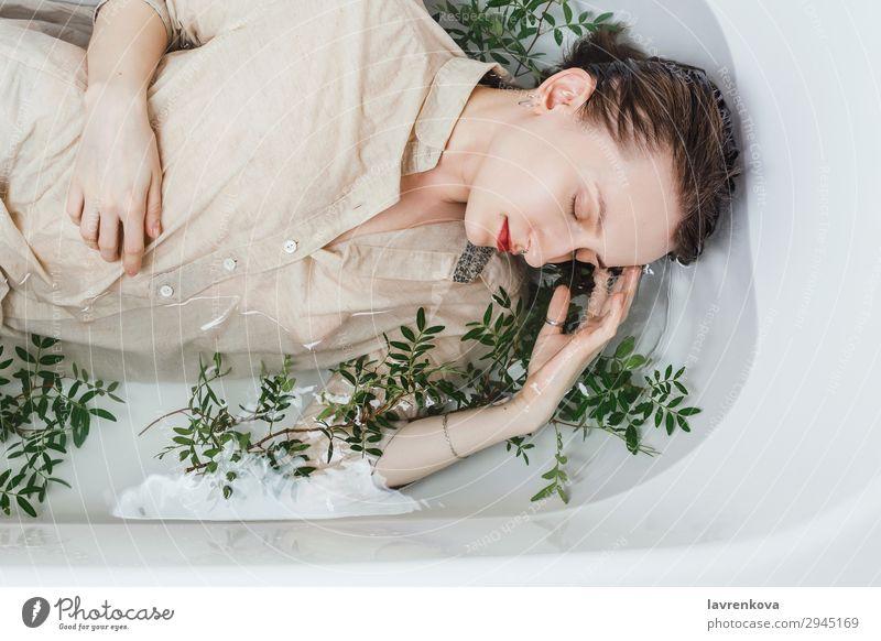 Female lying in bathtub with pistachio branches Attractive Swimming & Bathing Bathroom Bathtub Beautiful Branch Personal hygiene Caucasian eyes closed Woman