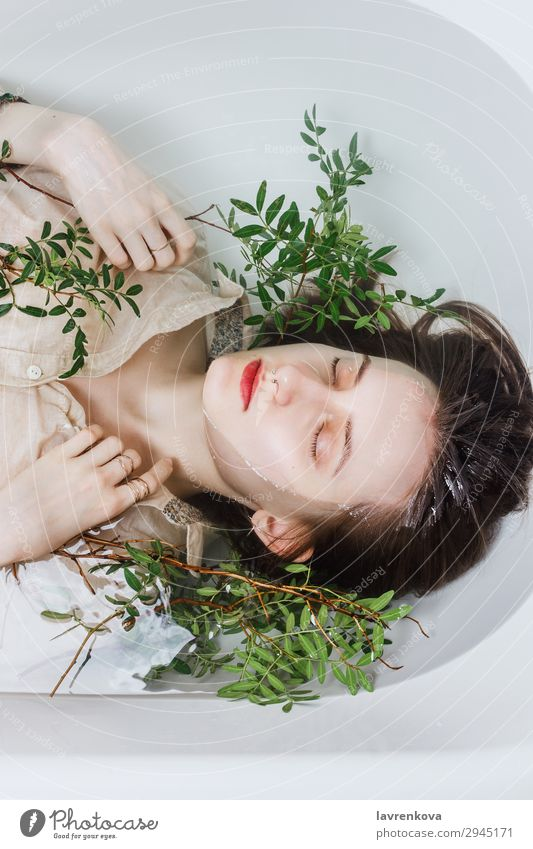 Female lying in bathtub with pistachio branches Tub Attractive Swimming & Bathing Bathroom Bathtub Beautiful Branch Personal hygiene Caucasian Woman Flower