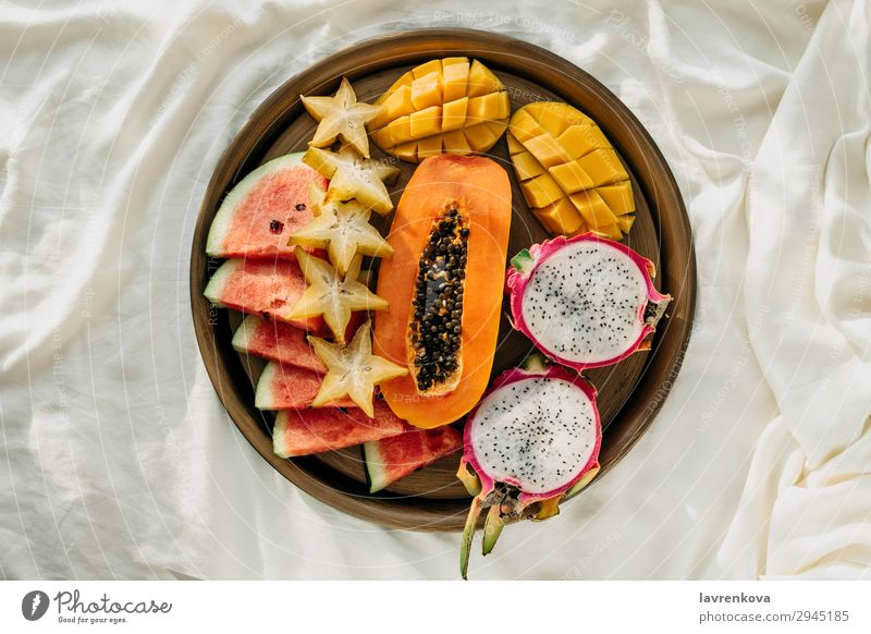 Various exotic tropical fruits on a metal tray in bed Bedroom Breakfast Carambole Cut Delicious Dessert Diet Dragonfruit Exotic flat flatlay Food Healthy Eating