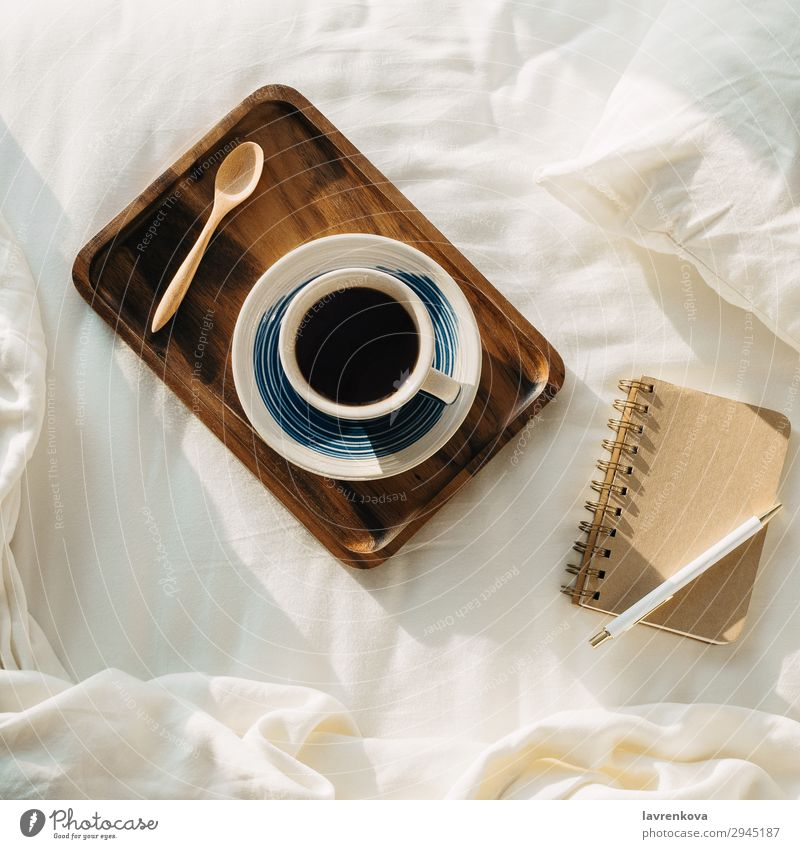 Coffee on wooden tray with notebook and pen on bed Neutral Background Bedroom Beverage Breakfast Brown Cup flat flatlay Hot Morning Mug Notebook Paper Pen