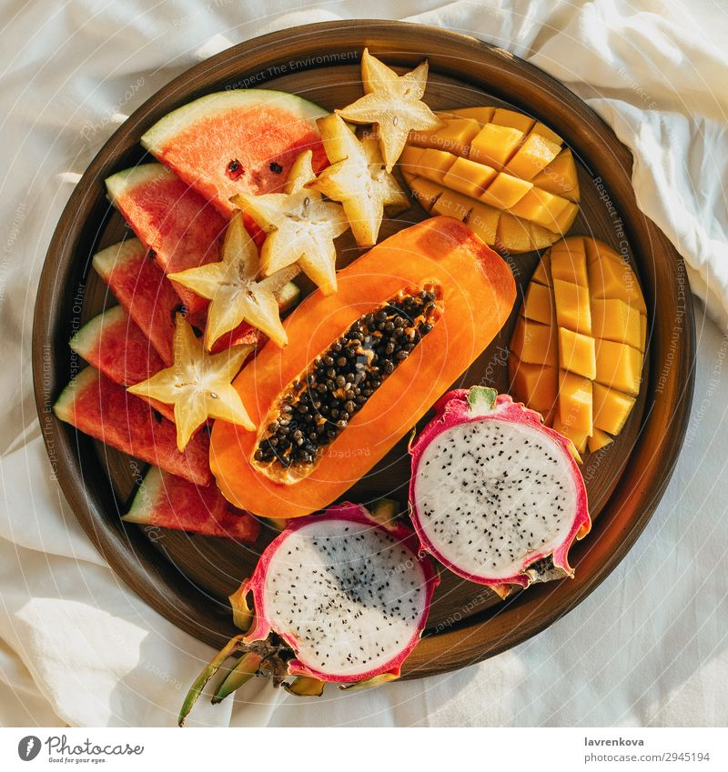 various exotic tropical fruits on a metal tray on bed Bedroom Breakfast Carambole Cut Delicious Dessert Diet Dragonfruit Exotic flat flatlay Food Healthy Eating