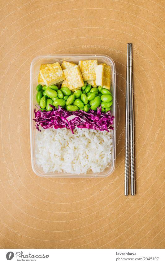 Healthy asian-style vegan bento box Red cabbage Tasty Green Cooking metal chopsticks take away lunch box zero waste Healthy Eating Frying edamame Tofu