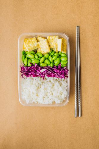 Healthy asian-style vegan bento box Red cabbage Tasty Green Cooking metal chopsticks take away lunch box zero waste Healthy Eating Frying edamame Tofu