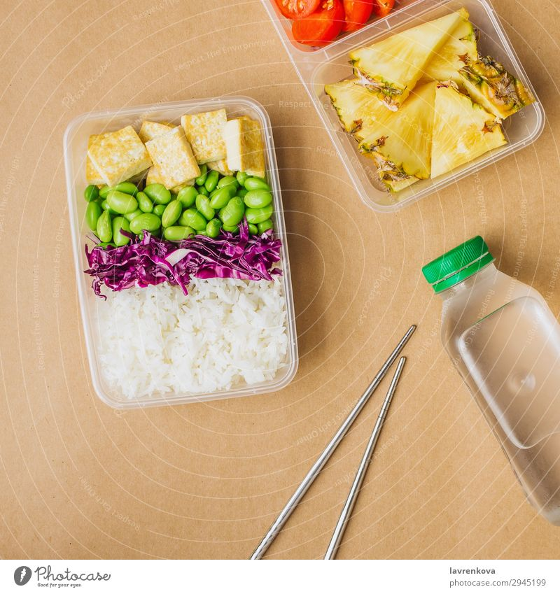 Healthy asian-style vegan bento box Square Green Bottle Water flat lay cherry tomatoes Cut Pineapple Red cabbage Tasty Cooking metal chopsticks takeaway