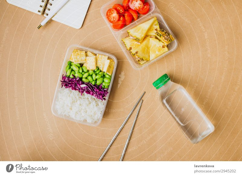 Healthy asian-style vegan bento box Pen Notebook Planer Bottle Water flat lay Tomato Cut Pineapple Red cabbage Tasty Chopstick takeaway lunch box zero waste