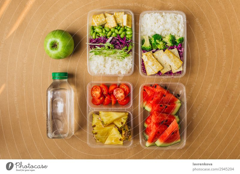 Two healthy asian-style vegan lunch bento boxes Organic Container Nutrition School Apple sprouts Broccoli Water melon Asian Food Asian rice dish cherry tomatoes