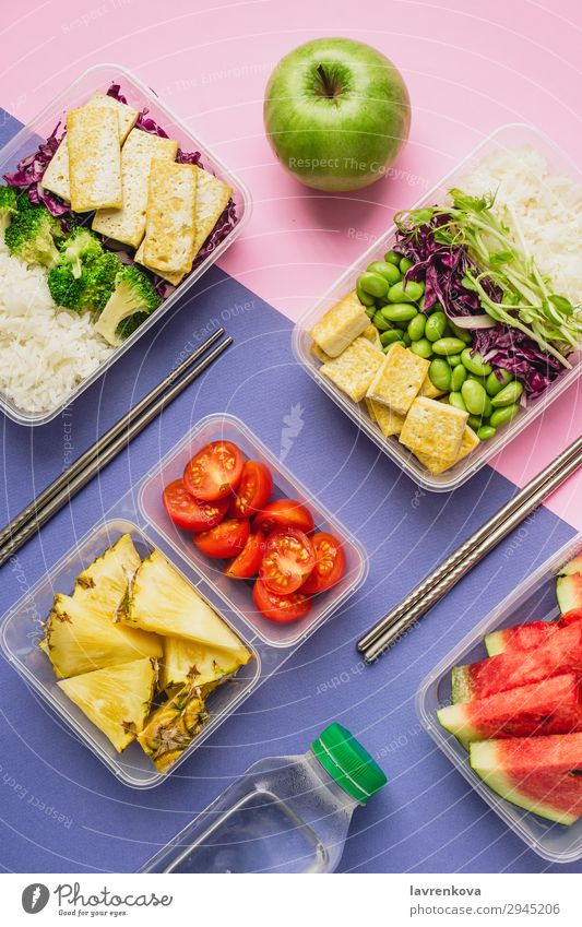 Two healthy asian-style vegan lunch bento boxes Bottle knolling Apple flatlay Asian Food Asian rice dish Broccoli Tomato Container Delicious Diet Dinner Dish