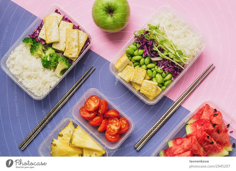 Two healthy asian-style plant-based lunch boxes knolling Apple flatlay Asian Food Asian rice dish bento Broccoli Tomato Container Delicious Diet Dinner Dish