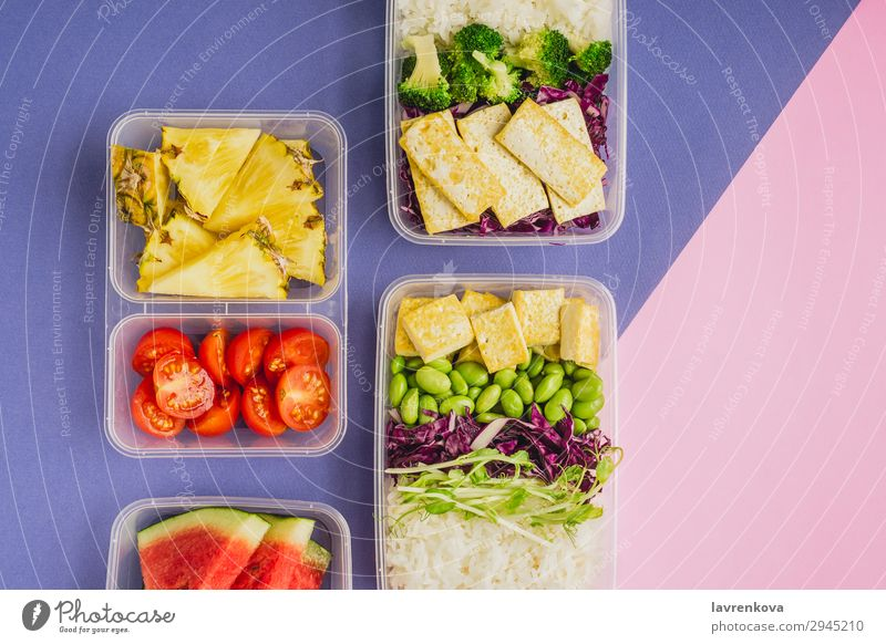 Two healthy asian-style plant-based lunch boxes knolling flatlay Asian Food Asian rice dish bento Broccoli Tomato Container Delicious Diet Dinner Dish edamame
