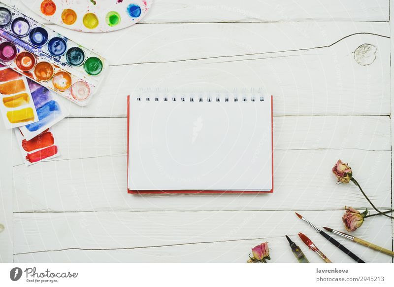 sketchbook blank page on wooden table with palette Artist Brush Business Multicoloured Conceptual design Creativity Decoration Design Desk