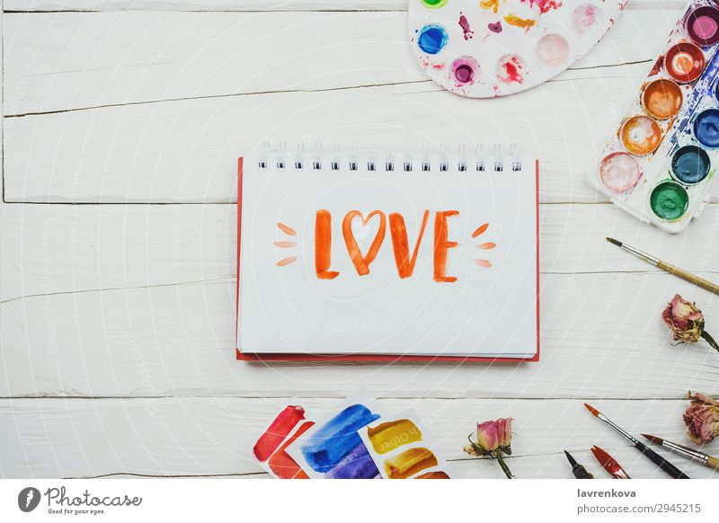 """sketchbook with handlettering inscription """"Love"""" Notebook Communication Artist Background picture Beautiful Brush Business Multicoloured Conceptual design"""