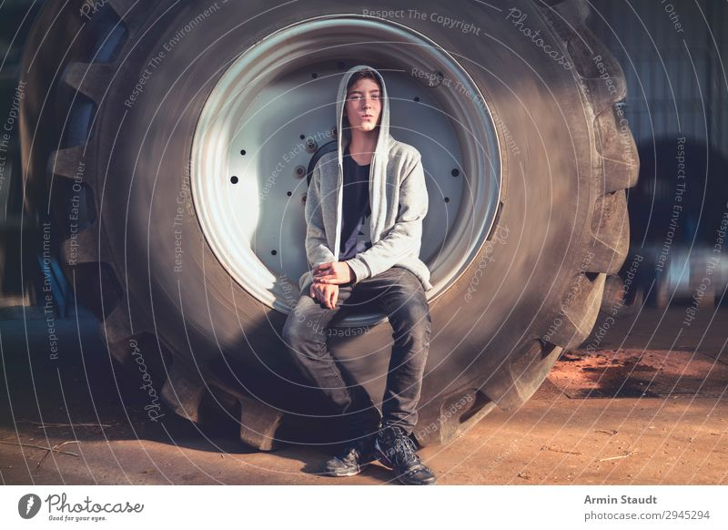 Portrait in tractor tyre II Lifestyle Style Beautiful Well-being Senses Relaxation Adventure Work and employment Workplace Human being Masculine Young man