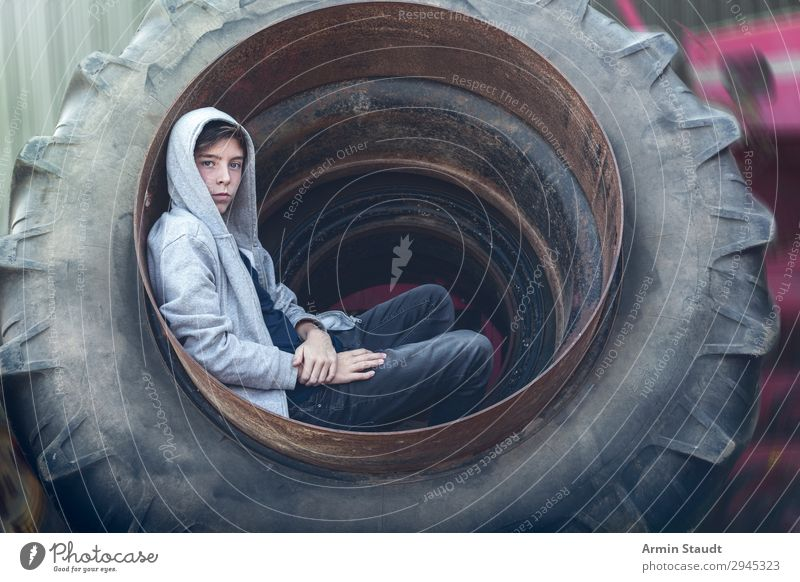 Portrait in a tractor tyre Lifestyle Style Beautiful Well-being Senses Relaxation Adventure Work and employment Workplace Human being Masculine Young man