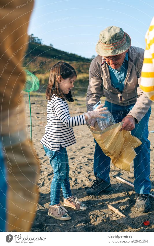 Volunteers cleaning the beach Happy Beach Child Work and employment Human being Woman Adults Man Grandfather Family & Relations Environment Sand Hat Plastic Old