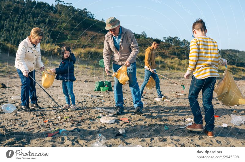 Volunteers cleaning the beach Beach Child Work and employment Human being Boy (child) Woman Adults Man Family & Relations Group Environment Old Dirty Teamwork