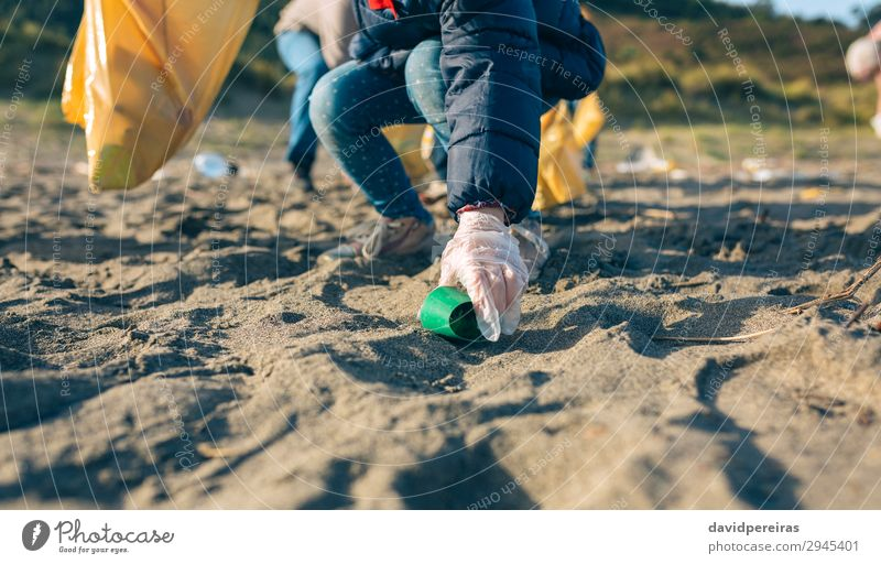 Little girl cleaning the beach Woman Child Human being Hand Beach Adults Environment Family & Relations Small Group Work and employment Sand Dirty Plastic Trash