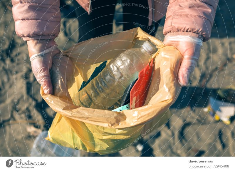 Woman showing garbage collected from the beach Beach Child Work and employment Human being Adults Hand Environment Sand Plastic Dirty Teamwork Indicate