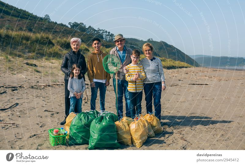 Volunteers posing after cleaning the beach Beach Child Human being Boy (child) Woman Adults Man Family & Relations Group Environment Old Smiling Pride Teamwork