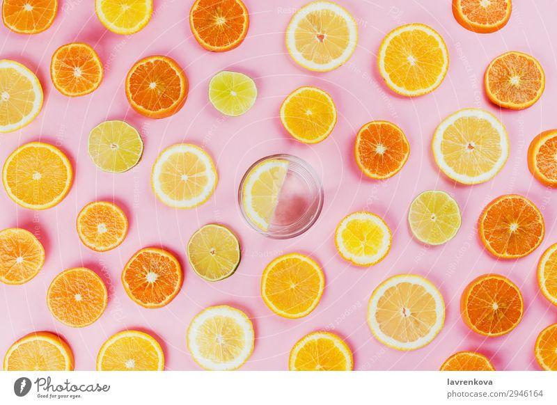 lemon water with various sliced citrus fruits Citrus fruits Cut Diet flat lay Food Healthy Eating Dish Fresh Fruit Hand Lemon Lime Orange Organic Pink Mature