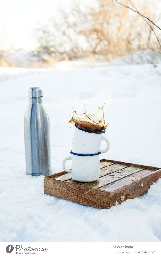 Two enamels mugs with splashing coffee outdoors Vacation & Travel Cup Mug Enamel Splash Autumn Exterior shot Tray Box Hiking Picnic Metal Bottle thermos Brown